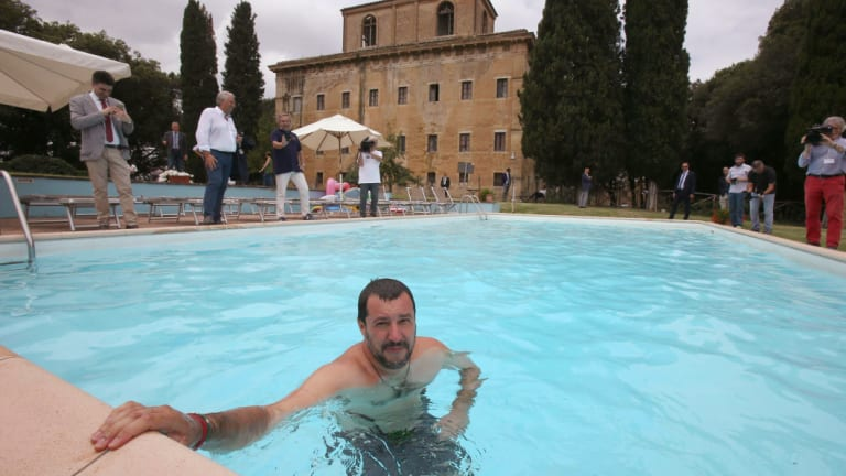 Interior Minister Matteo Salvini bathes in the swimming pool as he visits a villa seized in 2007 from a Cosa Nostra boss, in Suvignano, near Siena, central Italy.