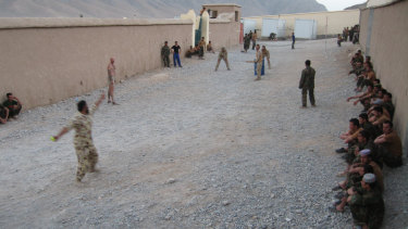 Australians and Afghans playing cricket in Chora Valley, Afghanistan, in 2008, with SAS sergeant Harry Moffitt taking strike.