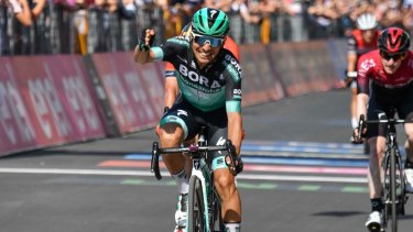 Italy's Cesare Benedetti celebrates a rare victory after winning the 12th stage of the Giro.