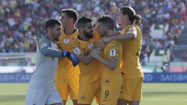 The Socceroos celebrate Jamie Maclaren's opening goal against Palestine.