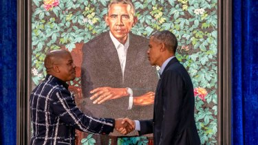 Kehinde Wiley painted a pensive Barack Obama in front of a lush background of flowers representing parts of the former president's life story.