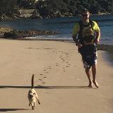 Gus joins his human, Glenn Druery, on a beach run.