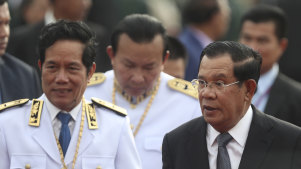 Cambodian Prime Minister Hun Sen, right, says his government has defeated an attempt at a coup.
