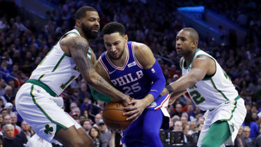 Ben Simmons tries to get past Celtics duo Marcus Morris and Al Horford.