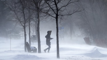 A pedestrian makes their way through frigid temperatures around Lake Bde Maka Ska in Minneapolis.