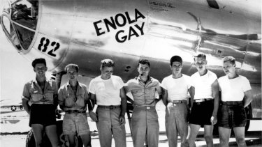 The ground crew of the Enola Gay with pilot Colonel Paul Tibbets (centre).