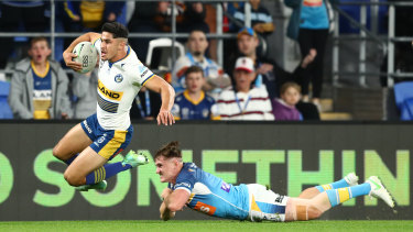 Dylan Brown scores the first try for the Eels.