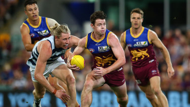 Fairest and best: 2020 Brownlow Medal winner Lachie Neale on the run for Brisbane during the Lions' preliminary final loss to the Cats on Saturday night.