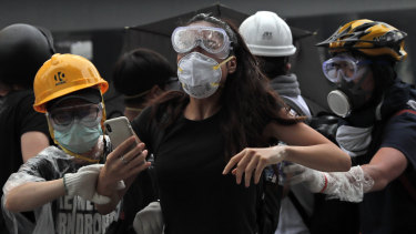 Protesters in Hong Kong flee the tear gas fired at them by police.
