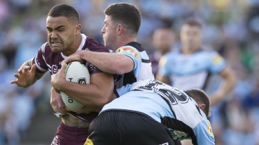 Making up for lost time: Walker back in action for Manly against the Sharks.