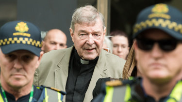 George Pell leaving court on Tuesday after a suppression order preventing publication of his crimes was lifted.