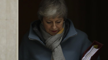 Britain's Prime Minister Theresa May leaves 10 Downing Street to attend the weekly Prime Minister's Questions session on Wednesday.