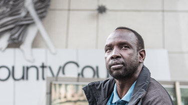 Former MA security guard Ngor Kuany says he is owed more than $55,000 in unpaid wages.