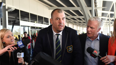 Outgoing Wallabies coach Michael Cheika arrives at Sydney Airport on Tuesday.
