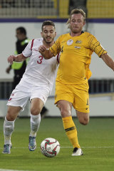 Defender Ryan Grant duels for the ball with Syria's defender Mouaiad Al Ajjan.