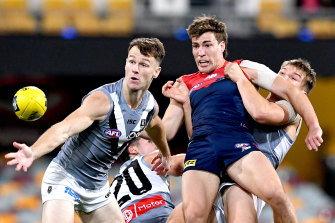 Melbourne's Jack Viney is swarmed by Port Adelaide opponents.