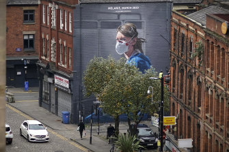 A mural depicting NHS nurse Melanie Senior in Manchester. The NHS is said to be close to collapse in the UK.