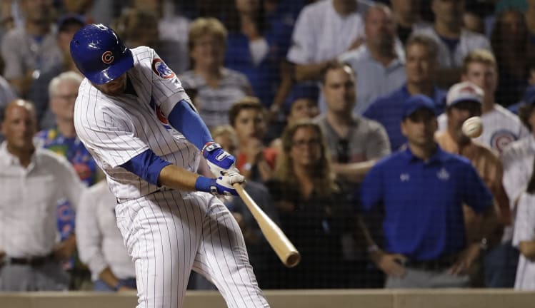 Chicago Cubs' David Bote hits the game-winning grand slam.