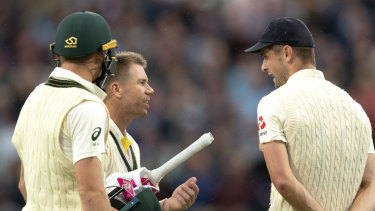 David Warner and Chris Woakes exchange words as the players came off for a delay.