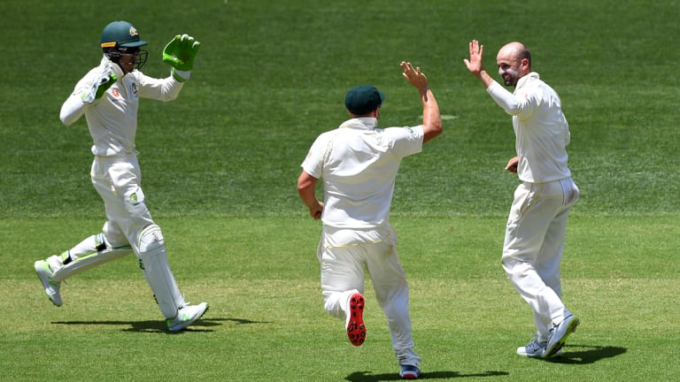 Over-spin, dip and bounce: Nathan Lyon reacts after dismissing Rohit Sharma.