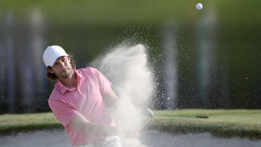 Aaron Baddeley hits out of a bunker onto the 17th green during the third round of the Arnold Palmer Invitational  tournament.