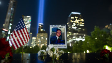 A picture of Robert Hughes who lost his life in the September 11 attacks is seen at ground zero while the Tribute in Light rises in the background, in Lower Manhattan on Wednesday.