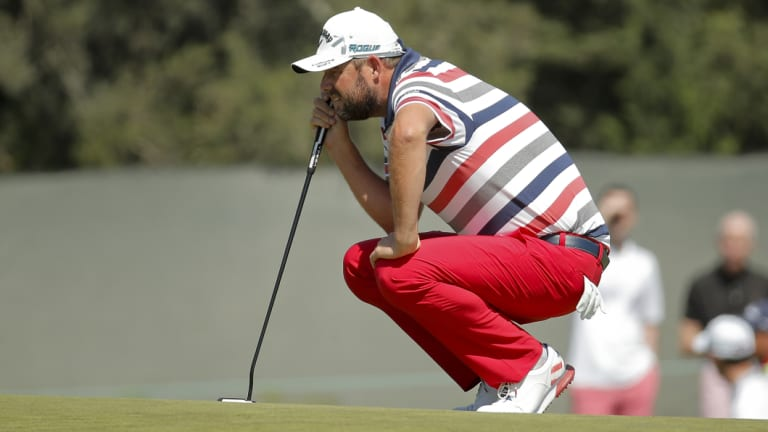 On the line: Marc Leishman lines up a birdie putt.