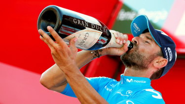 Well earned drink: Alejandro Valverde of the Movistar Team celebrates on the podium after the second stage.
