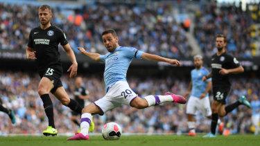 Walkover: Manchester City's Bernardo Silva scores his side's fourth goal at Etihad Stadium.