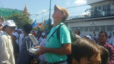 In this photo from Cambodian website Fresh News, Australian filmmaker James Ricketson is seen apparently operating a drone at a rally.