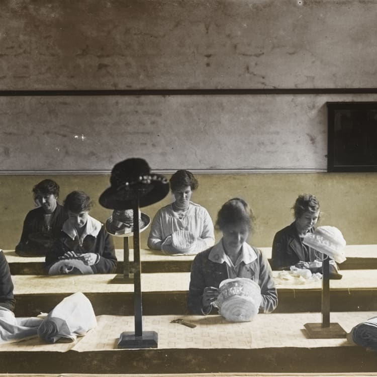 A millinery class for wives of men killed in action, 1919.