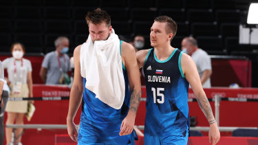 Luka Doncic #77 of Team Slovenia and teammate Gregor Hrovat #15 of walk off the court in disappointment following their loss to Team France.