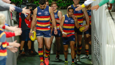Taylor Walker prepares to lead the Crows out.