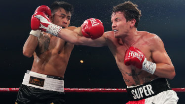 Darragh Foley and James Bacon trade blows during their super lightweight bout.
