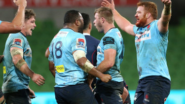 Alive and kicking: the Waratahs celebrate their victory.