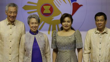 Philippine President Rodrigo Duterte, right, and his partner Honeylet Avancena, second right, with Singapore Prime Minister Lee Hsien Loong, left, and his wife last year.