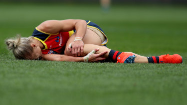 Erin Phillips clutches her knee after going down in the third quarter of the grand final.