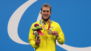 Will Martin celebrates won a gold medal in the S9 400m freestyle final.