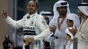 Hamilton celebrates on the podium at the Yas Marina Circuit in Abu Dhabi.