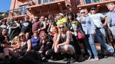 Regulars and musicians gather outside the Dog's Bar in St Kilda on Wednesday afternoon after news of its closure.