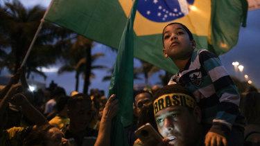 Supporters of Jair Bolsonaro wait for his victory speech, in Rio de Janeiro.