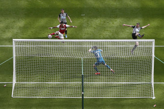 Arsenal's Pierre-Emerick Aubameyang scores against Newcastle United at St James' Park.