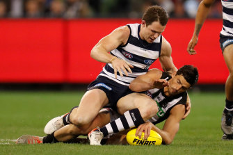Patrick Dangerfield and Scott Pendlebury compete for the ball in last Friday's qualifying final.