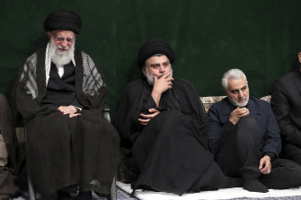 From left: Supreme Leader Ayatollah Ali Khamenei, Iraqi Shiite cleric Muqtada al-Sadr and Qasem Soleimani, the now deceased commander of Iran's Quds Force, attend a mourning ceremony in September 2019.