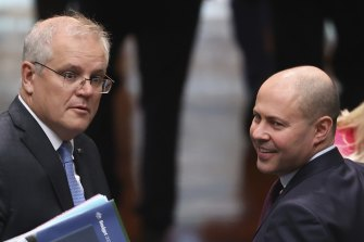 Prime Minister Scott Morrison and Treasurer Josh Frydenberg during Question Time at Parliament House in Canberra.