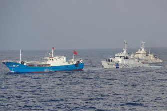 A suspected illegal Chinese fishing boat being monitored by the Japan Coast Guard.