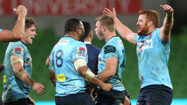 The Waratahs celebrate their victory.
