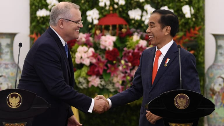 Prime Minister Scott Morrison with Indonesian President Joko Widodo at the Presidential Palace on Friday night.