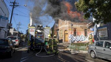 Emergency crews respond to a fire on Australia Street.