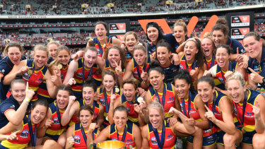 The Crows celebrate with the 2019 AFLW premiership cup.